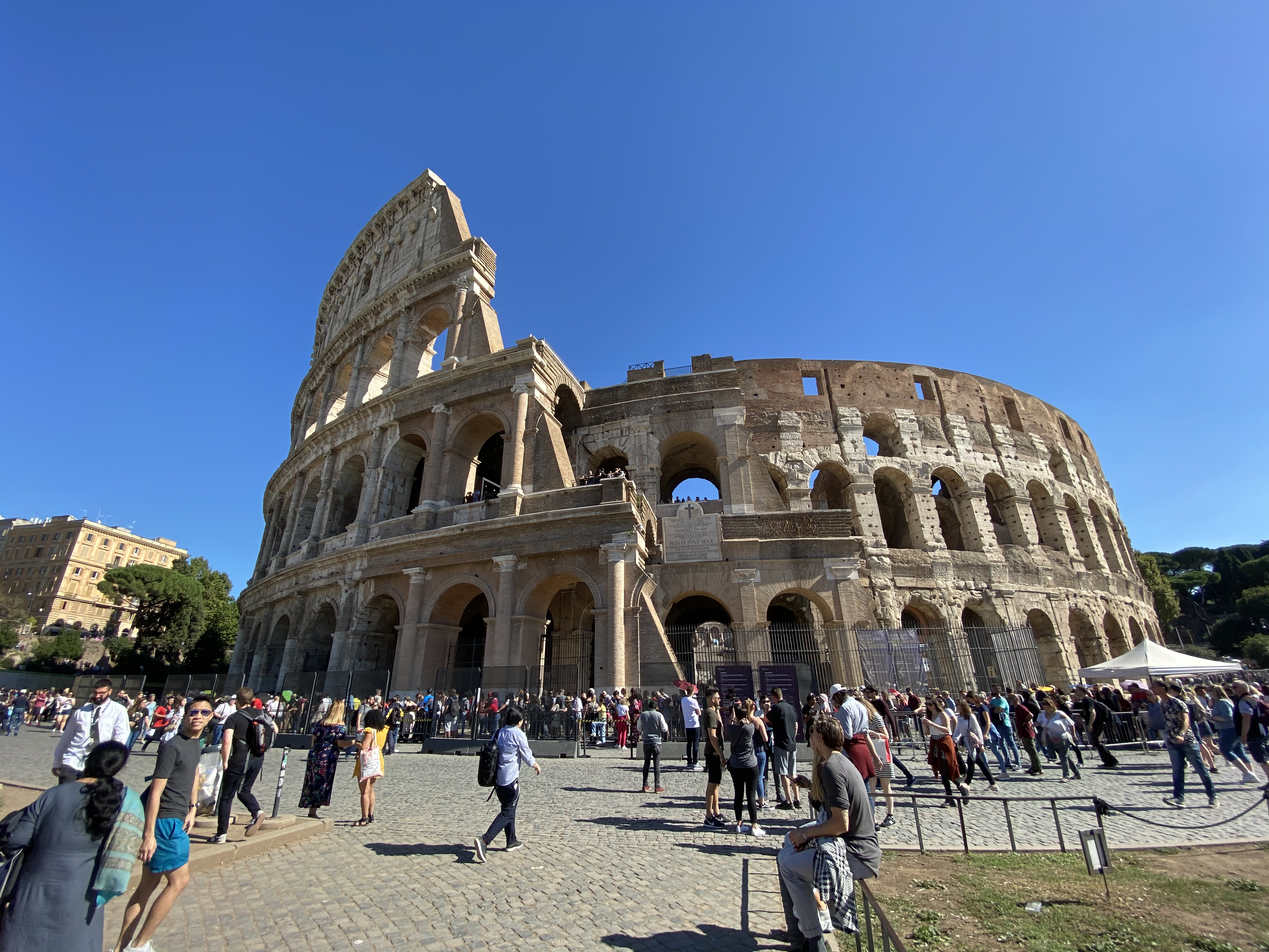 Ultra-wide Colosseum during the day.